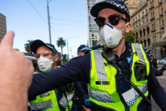 MELBOURNE, AUSTRALIA - MAY 10: Police fight with protesters during COVID 19 Anti Lockdown protest at Parliament House on 10 May, 2020 in Melbourne, Australia. (Photo by Speed Media/Icon Sportswire)