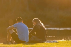 MELBOURNE, AUSTRALIA - MAY 17: A couple sit beside the lake in the Botanical Gardens after it reopens from a two month shut down as restrictions are being eased in Victoria during COVID 19 on 17 May, 2020 in Melbourne, Australia. (Photo by Speed Media/Icon Sportswire)