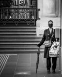 MELBOURNE, AUSTRALIA - JULY 29: A woman wearing a facemask is seen waiting for a tram on Bourke Street during COVID 19 on 29 July, 2020 in Melbourne, Australia. As sustained high numbers of new Coronavirus cases are being discovered, Metropolitan Melbourne and the Mitchell Shire remain under Stage 3 restrictions with facemasks being made mandatory on 23 July. 295 new cases were found overnight bringing the states total active case numbers to 4,775. (Photo by Speed Media/Icon Sportswire)