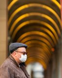 MELBOURNE, AUSTRALIA - JULY 29: A man is seen wearing facemask standing under the arches of the the Melbourne GPO Building during COVID 19 on 29 July, 2020 in Melbourne, Australia. As sustained high numbers of new Coronavirus cases are being discovered, Metropolitan Melbourne and the Mitchell Shire remain under Stage 3 restrictions with facemasks being made mandatory on 23 July. 295 new cases were found overnight bringing the states total active case numbers to 4,775. (Photo by Speed Media/Icon Sportswire)