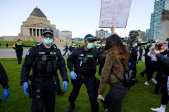 MELBOURNE, VIC - SEPTEMBER 05: Public Order Response Police violently push a woman back as the march towards protesters during the Anti-Lockdown Protest on September 05, 2020 in Sydney, Australia. Stage 4 restrictions are in place from 6pm on Sunday 2 August for metropolitan Melbourne. This includes a curfew from 8pm to 5am every evening. During this time people are only allowed to leave their house for work, and essential health, care or safety reasons. (Photo by Speed Media/Icon Sportswire)